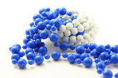 Blue beads isolated — Stock fotografie