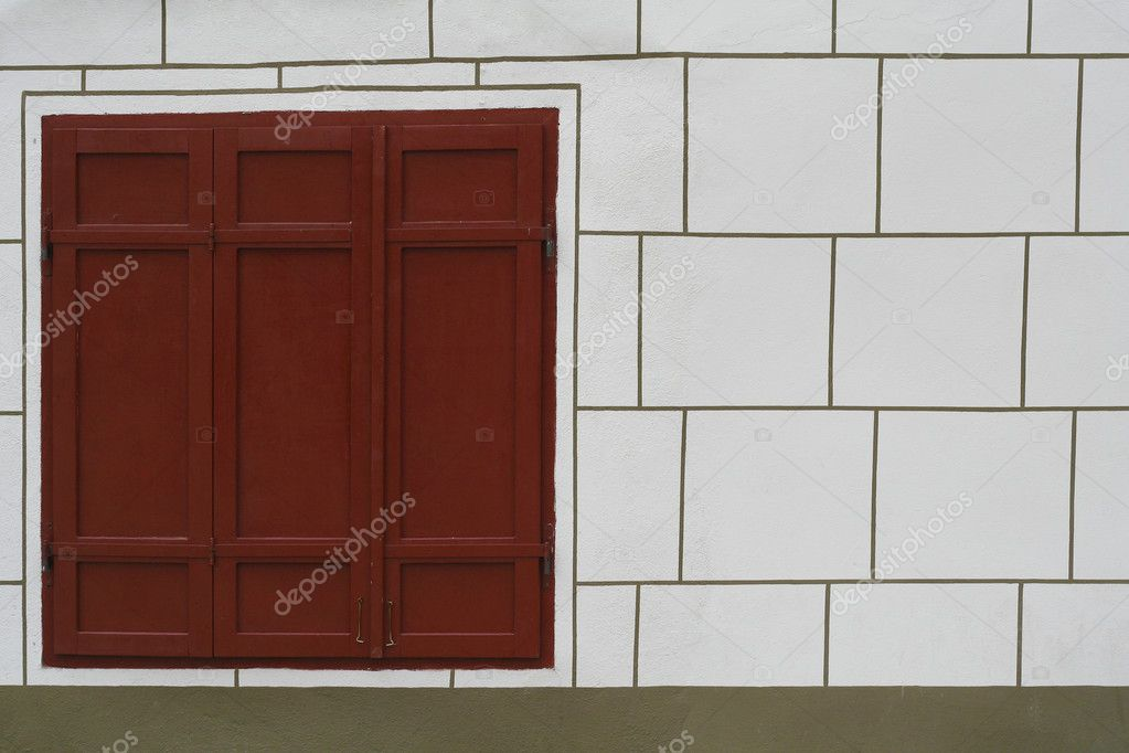 Red window on white wall — Stock Photo #2012951