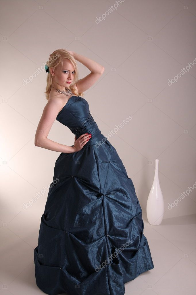 Beautiful young woman wearing a blue prom dress   #2009815