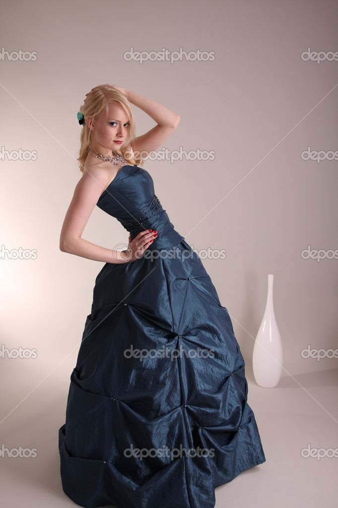 Beautiful young woman wearing a blue prom dress  Foto Stock #2009815