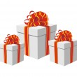 Gift boxes with red and golden ribbons — Stock Vector