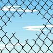 Cut wire fence with blue sky background - Stock Vector