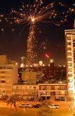 Christmas Fireworks celebration over the city. — Stock Photo