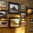 Pictures hanging on a wall — Foto Stock