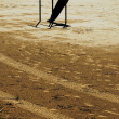 Stock Photo: Mdoing parallel bars on beach