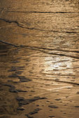Golden waves texture on the beach — Stock Photo