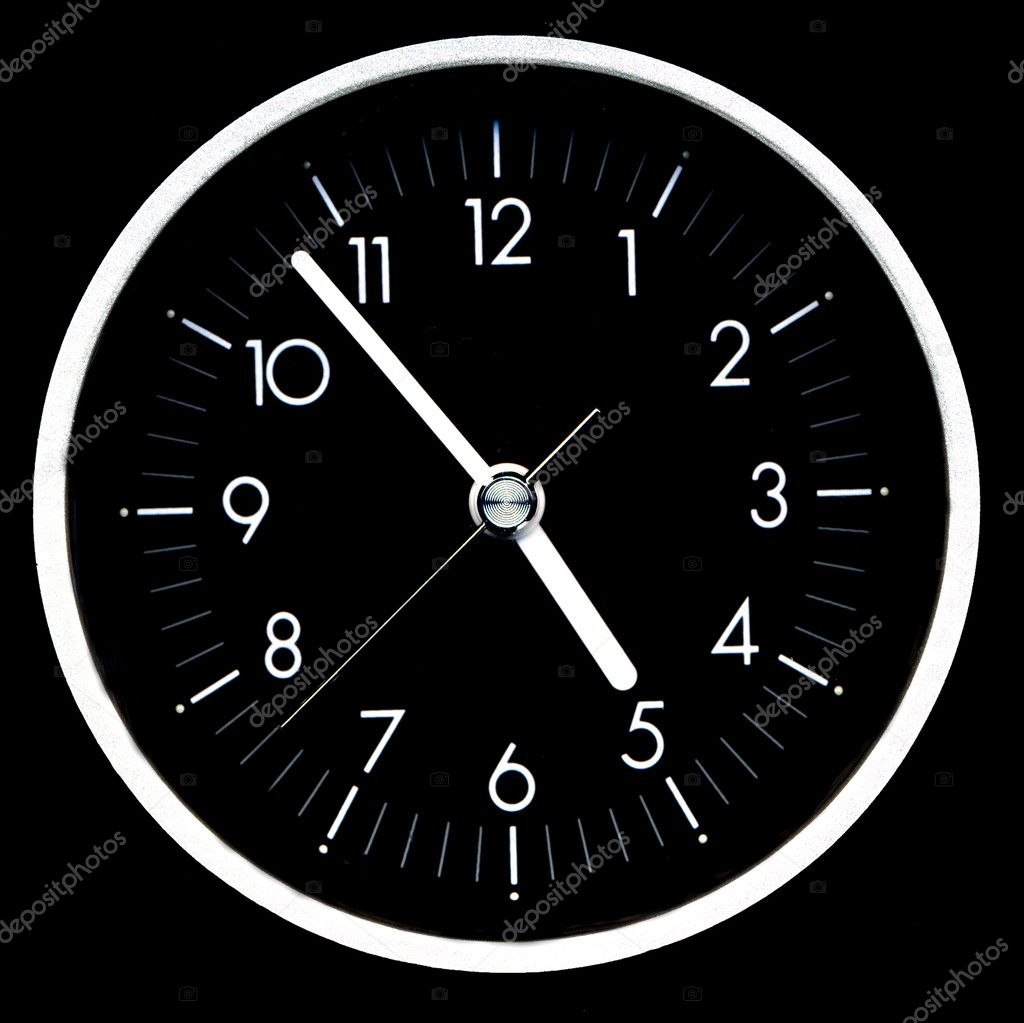 Black clock face with white hands and numbers — Stock Photo #2063426