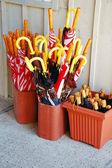 Umbrellas in buckets — Stock Photo