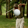 Golf ball in flight — Stock Photo