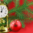 Christmas tree with gold wacth — Stock Photo