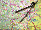 Compasses on map — Stock Photo