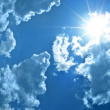 Stock Photo: Cloudscape with sun