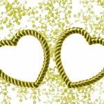 Gold heart-shaped frame on floral backg — Stock Photo #2070585