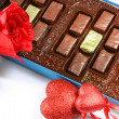 Box of chocolates, a rose and a Valentin — Stock Photo
