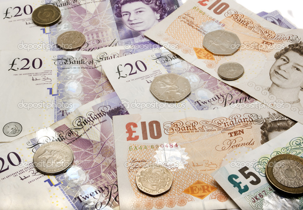 British currency with different value notes and coins — Stock Photo #2046734