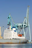 Port cranes and ship — Stock Photo