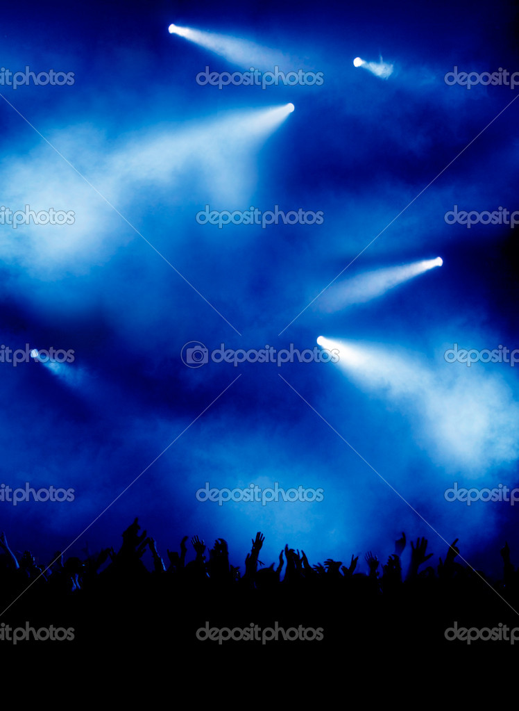 Blue background with impressive concert lighting, lots of partying — Stock Photo #2087680