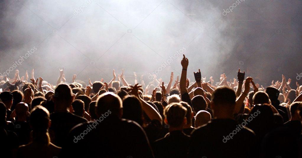 Crowd raising hand