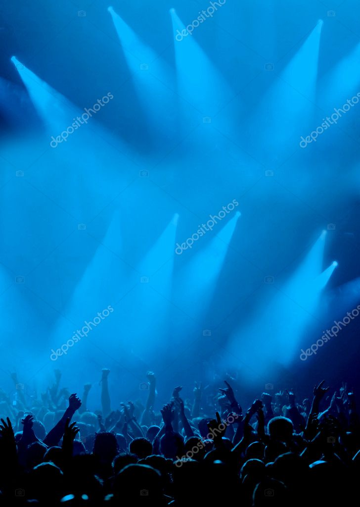 Silhouette of cheering crowd raising hands, cyan blue background with dramatic concert lighting — Stock Photo #2087791