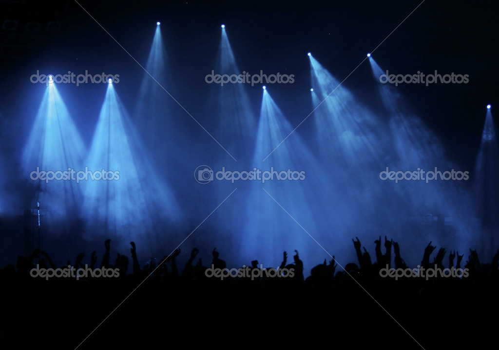 Silhouette of hundreds of fans raising hands at a concert, elegant blue lights — Stock Photo #2087999