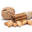 Stock Photo: Nuts and cinnamon isolated