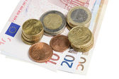 Currency and coins — Stock Photo