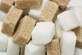 White and brown sugar cubes — Stock Photo