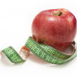 Red apple measured the meter — Stock Photo