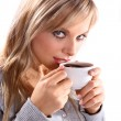 Beautiful woman holding a cup of coffee - Stock Photo