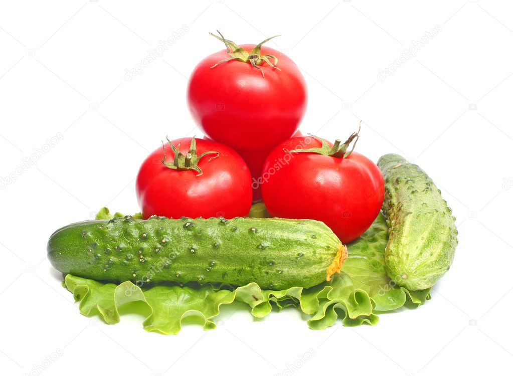 Red tomatoes and green cucumbers and lettuce isolated on white background  Stock Photo #2051526