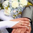 Hands and wedding rings - Stock Photo