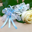 Stock Photo: Wedding garter and rose