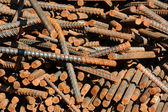 A pile of rusty rebar background — Stock Photo