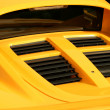 Stock Photo: Yellow sports car rear view