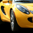Isolated yellow sports car on black - Stok fotoraf