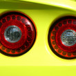 Royalty-Free Stock Photo: Yellow sports car red tail lights