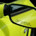 Yellow sports car mirror — Stock Photo