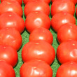Stock Photo: Tomatoes lined up for sale