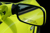 Yellow sports car mirror — Stok fotoğraf