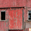 Old red barn door with windows — Stock Photo