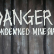 Danger condemned mine shaft — Stock Photo