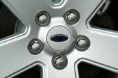 Car tire wheel and lug nuts — Stock Photo