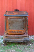 Old rusty cast iron stove — Stock Photo