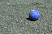 Blue bocce ball on a court — Stock Photo
