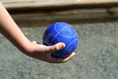 Hand holding a bocce ball — Stock Photo