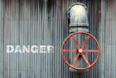 Large wheel valve with danger — Stock fotografie