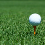 A White golf ball on a orange tee — Stock Photo #2040127