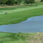 Golf course fairway with water hazzard — Stock Photo