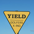 Stock Photo: Yield golfer crossing sign