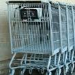 Grey metal shopping carts — Stock Photo